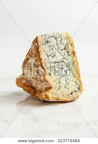 A piece of artisanal blue cheese, straight from the farm.