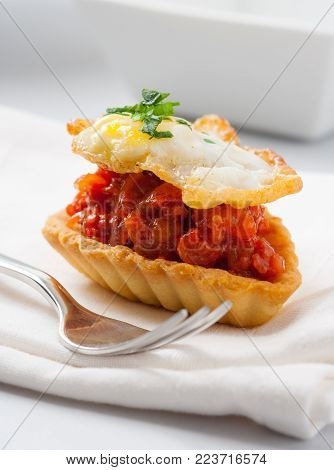 A delicious tartlet filled with Spanish chorizo sausage and topped with a fried quail egg.
