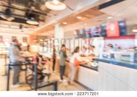 Blurred People Queue Behind Stanchion Barriers Bakery In America