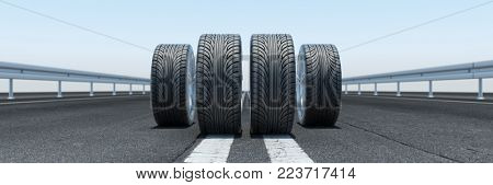 4 tires stand on a road as a concept for winter tires (3D Rendering)