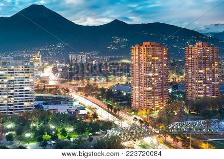 Elevated view of Las Condes district in Santiago de Chile and Manquehue Avenue with Manquehue hill in the back