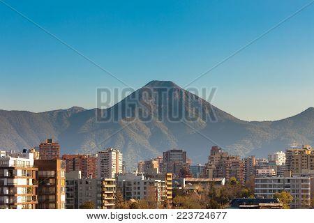 Skyline of apartment buildings in Las Condes district with Cerro Manquehue on the back, Santiago de Chile