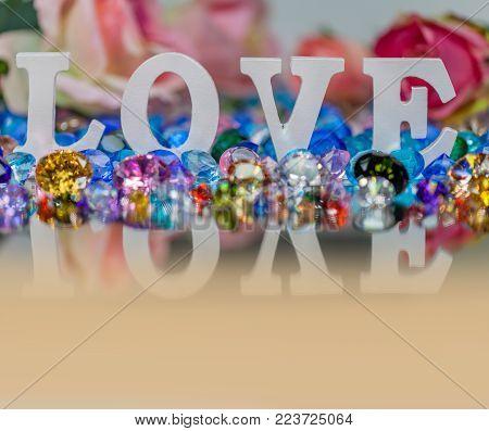White Love Letter Inside Colorful Diamonds.