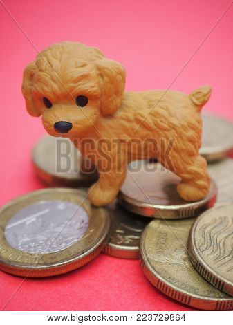 Happy Chinese New Year! 2018 Year of the Dog! Blessings for Chinese New Year 2018 (also known as Lunar New Year) on February 16. Cute little Dog on Red background next to a symbolic pile of 8 lucky gold coins.