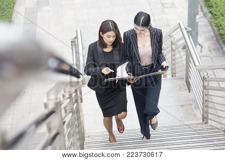 Business People Talking For Business Plan While Walking. Woman Walking Concept. 20-30 Year Old.