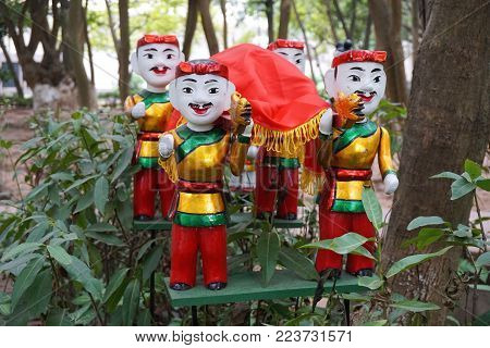 Colorful painted marionette doll figurines in a forest in Hanoi Vietnam