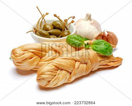 Smoked braided cheese and capers isolated on white background