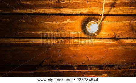 old vintage lamp on planks in a shed