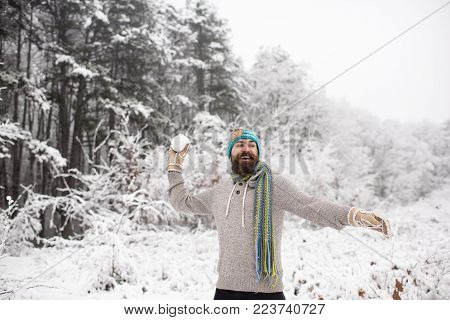 Hipster In Thermal Jacket, Hat, Scarf, Beard Warm In Winter. Sport, Rest, Activity. Bearded Man Smil