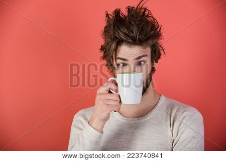 Morning With Coffee Or Milk. Surprised Guy With Tea Cup On Red Background. Cold And Flu, Single. Man