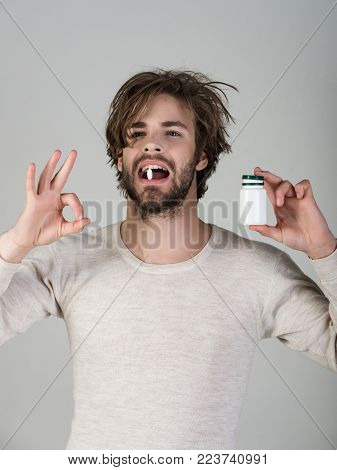 Drug And Antidepressant, Insomnia. Health And Medicine, Hangover. Man With Pills In Jar. Cold, Flu A