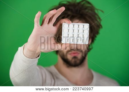 Man With Pills In Blister Pack. Drug And Antidepressant, Insomnia. Dieting Pill And Vitamin, Man Wit