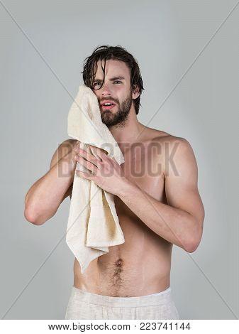 Man In Bathroom With Muscular Body On Grey Background. Hygiene, Sexy Guy Wash, Spa, Relax. Morning W