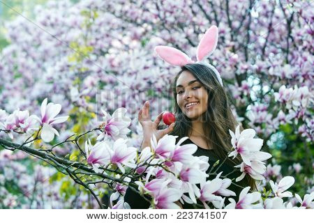 Happy Woman Or Adorable Girl With Rosy Bunny Ears On Long, Brunette Hair Smiling With Colored Red Eg