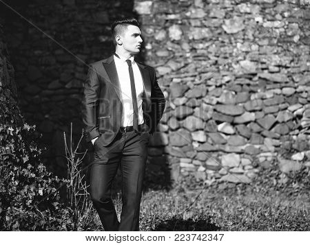 Man Half Face Young Handsome Elegant Model In Suit With Skinny Necktie Poses With Hands In Trouser P