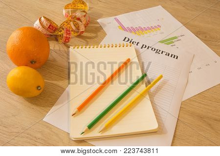 Diet weight loss breakfast concept with tape measure, organic fruits. Low-calorie fruit diet