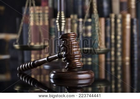 Legal system. Law and justice concept. Gavel of the jugde  in the court library.