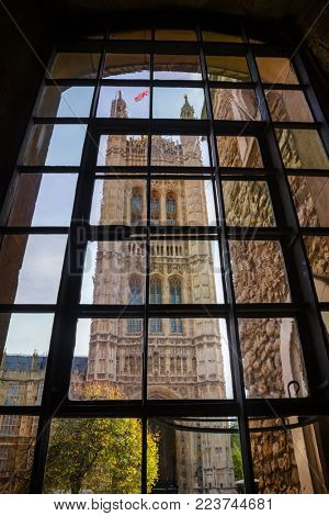 The Victoria Tower at the south-west end of the Palace of Westminster as viewed through medieval window of Jewel Tower, City of Westminster, Central Area of Greater London UK