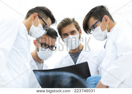 male doctors looking attentively at x-ray