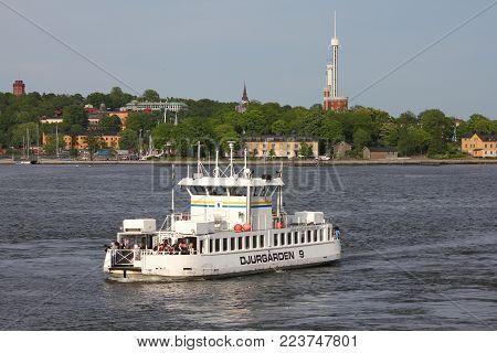 STOCKHOLM, SWEDEN - MAY 31, 2010: Djurgarden ferry transports passengers in Stockholm, Sweden. In Stockholm, city of islands, ferries are the backbone of public transport.