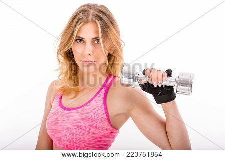 Young Fit Woman Posing  On White Background Beside Set Of Weights. Sport And Fittness Concept.