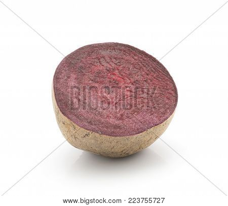 One beetroot half (raw red beet) isolated on white background