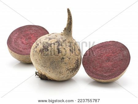 Beetroot (raw red beet) isolated on white background one bulb and two halves