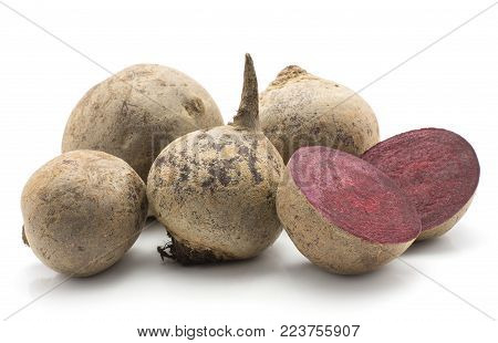 Beetroot (raw red beet) set isolated on white background four bulbs and one cut in half
