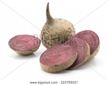 Beetroot (raw red beet) isolated on white background one bulb and four sliced rings
