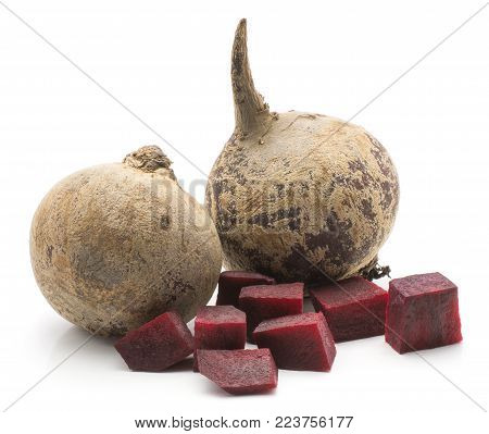 Two beetroot (raw red beet) bulbs and chopped pieces isolated on white background