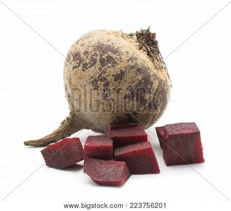 One beetroot (raw red beet) bulb and chopped pieces isolated on white background