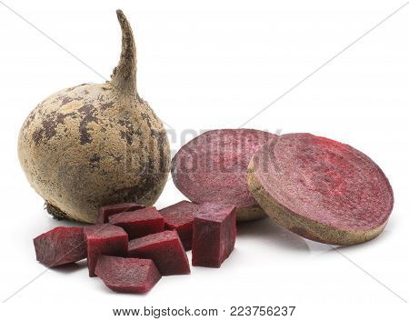 One beetroot (raw red beet) bulb, two ring slices, chopped pieces, isolated on white background