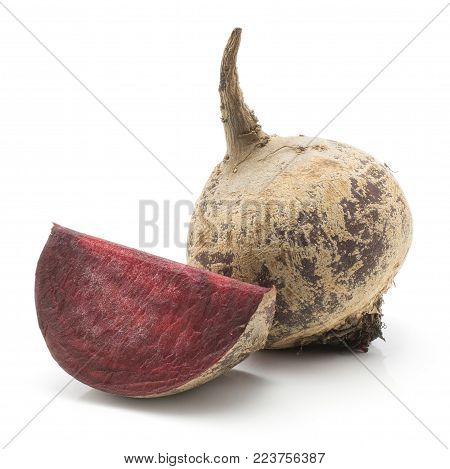 One beetroot bulb and one slice (raw red beet) isolated on white background