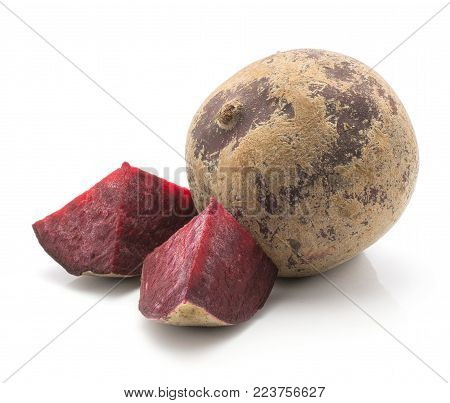 One beetroot bulb (raw red beet) and two pieces isolated on white background