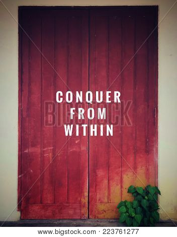 Motivational and inspirational quotes - Conquer from within. With vintage styled background.