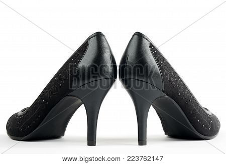 Pair of black new women's high-heeled shoes isolated on white