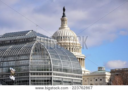 Architectural constructions of Washington. The Capitol and greenhouse of the Botanical garden adjoin on Capitol Hill.