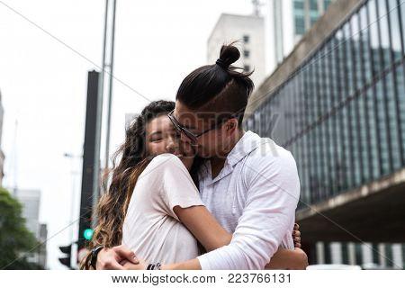 Young Asian Couple Embracing in Paulista Avenue, Sao Paulo, Brazil