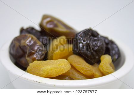 Bowl with dried apricots, dates and prunes