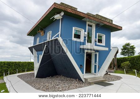 USEDOM, GERMANY - JULY 18, 2017: Upside Down House. Popular among the guests of the Usedom Island is a tourist attraction.