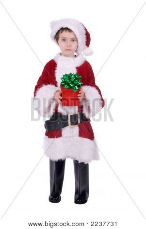 Boy In Santa Suit With Gift