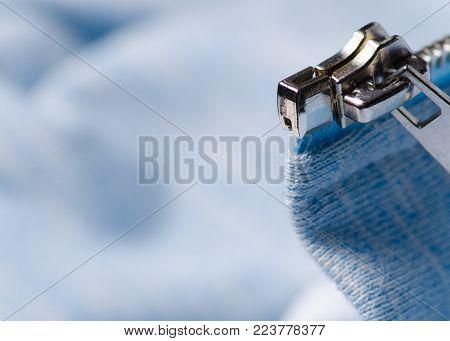 Blue white fabric clothes zipper lock shirt macro blurred background