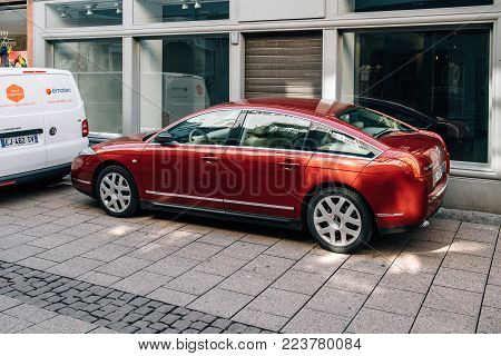 STRASBOURG, FRANCE - APR 21, 2017: Luxury red Citroen C6 luxury limousine on a French street