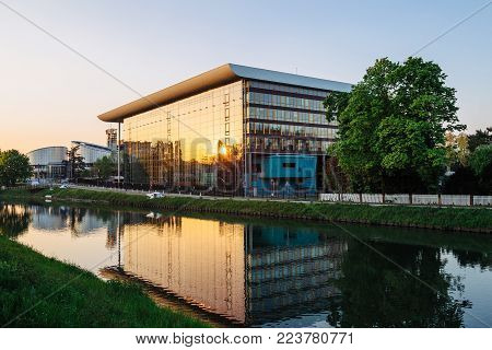 STRASBOURG, FRANCE - APR 21, 2017: Agora Council of Europe building in Strasbourg construction at sunset with sun reflected in window