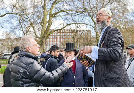 London, UK - April 17, 2016: Muslim fundamentalist preacher holding a Koran. Speakers Corner, Hyde Park, London England