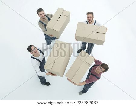 Movers lifting stack of cardboard moving boxes isolated on white