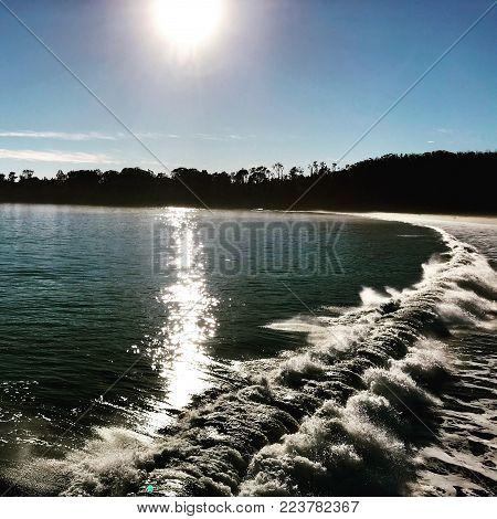 Sunbeams over Pacific Ocean waves near San Simeon, California