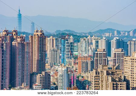 TAIPEI, TAIWAN - MARCH 27: City view of modern architecture and high rise buildings in the Xindian district of Taipei on March 27, 2017 in Taipei