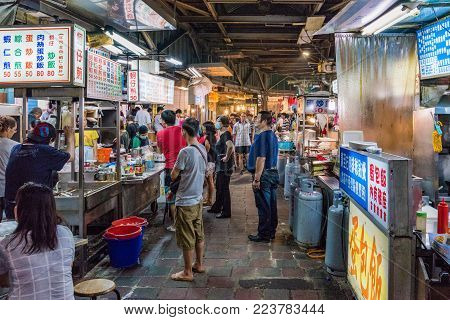 TAIPEI, TAIWAN - JULY 02: This is a night scene of Jingmei night market where many local Taiwanese people come at night to eat various types of Taiwanese food on July 02, 2017 in Taipei