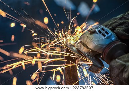 Sparks from an African man grinding metal